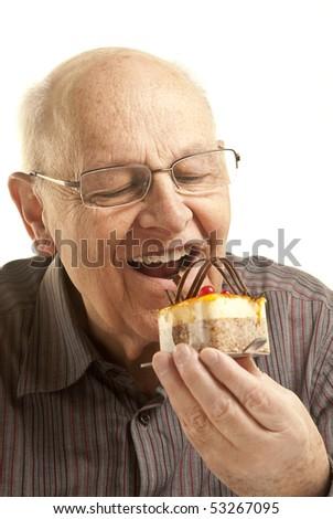 Senior man eating a cake, isolated on white - stock photo