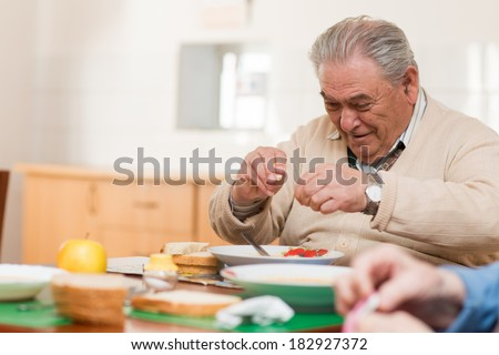 Senior man eating a healthy meal  - stock photo