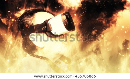 Senior Man Experiencing Virtual Reality Technology - Movie Video Game Simulation Concept - Fire Oven Hell Inferno Theme