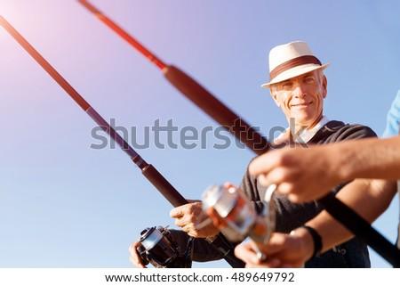 Senior man fishing sea side stock photo 481271293 for Senior fishing license