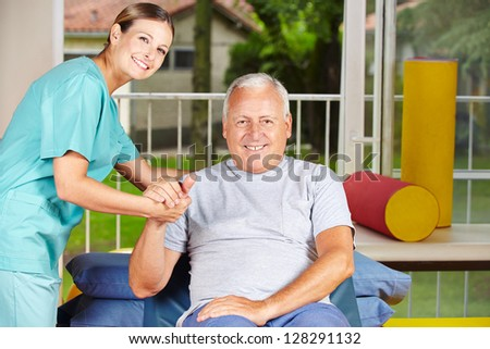 Senior man getting physiotherapy with a physiotherapist - stock photo