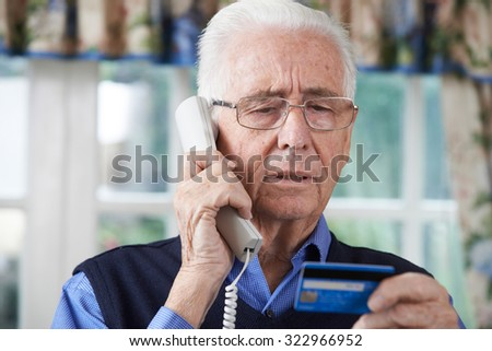 Senior Man Giving Credit Card Details On The Phone - stock photo