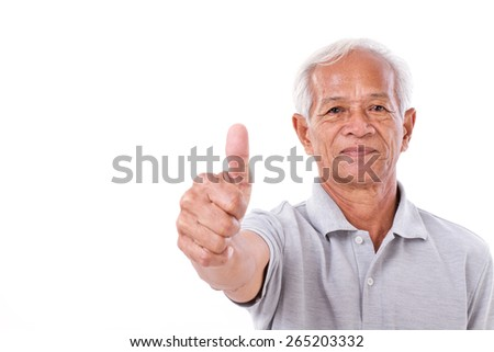 senior man giving thumb up - stock photo