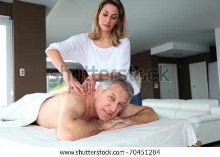 Senior man having a massage - stock photo