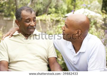 Senior Man Having Serious Conversation Adult Son - stock photo
