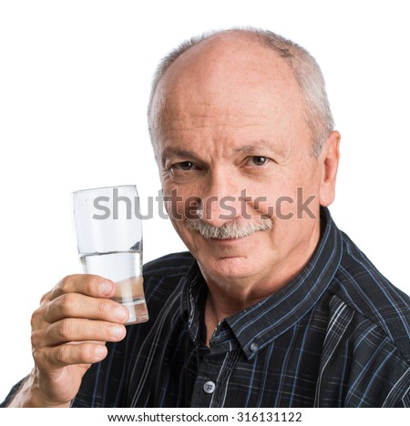 Senior man holding a glass of water  on a white background - stock photo