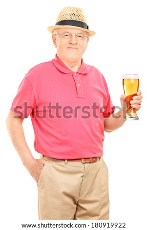 Senior man holding a pint of beer isolated on white background - stock photo