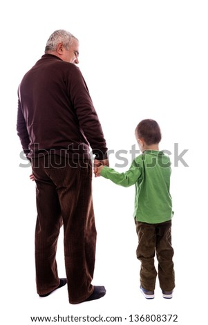 Senior man holding his grandson's hand, back view, isolated on white background - stock photo