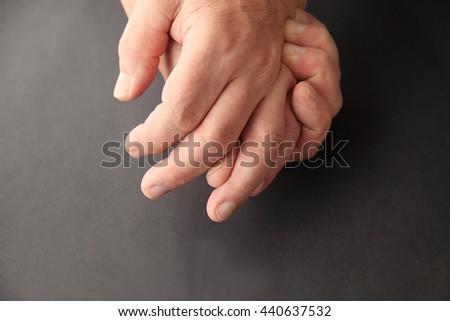 Senior man holding his painful hand - stock photo