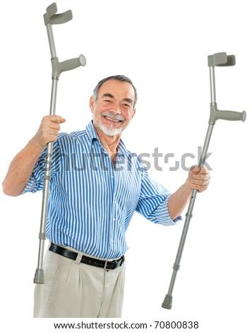 senior man holding the crutches smiling. - stock photo