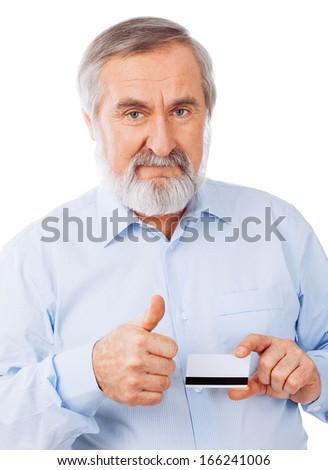 Senior man holding up a cash card Isolated on white background - stock photo