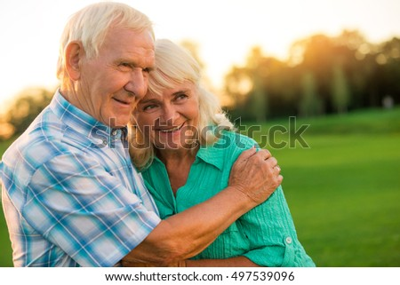 Senior man hugs woman. Smiling elderly couple outdoor. You're a gift of fate. Staying happy through the years.