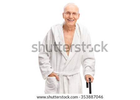 Senior man in a bathrobe holding a cane and looking at the camera isolated on white background - stock photo