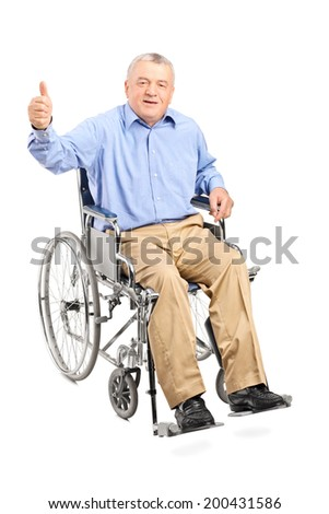 Senior man in a wheelchair giving a thumb up isolated on white background