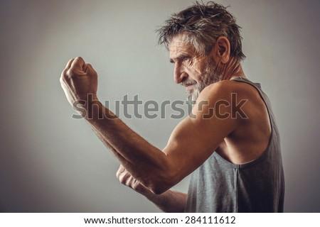 Senior man in fighting position - stock photo