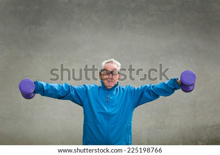 Senior man in his seventies training and lifting weigh - stock photo