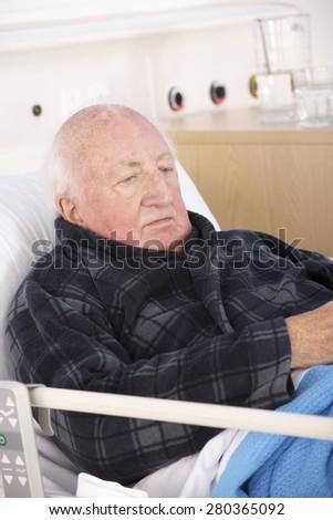 Senior man in hospital bed - stock photo