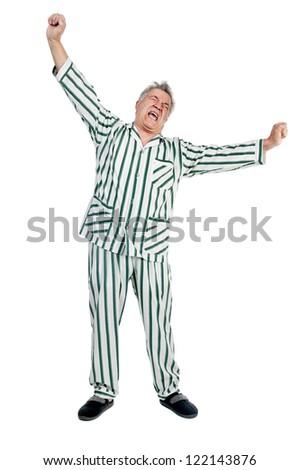 Senior man in pajamas isolated in white - stock photo