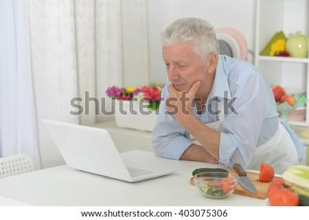 senior man  in the kitchen - stock photo