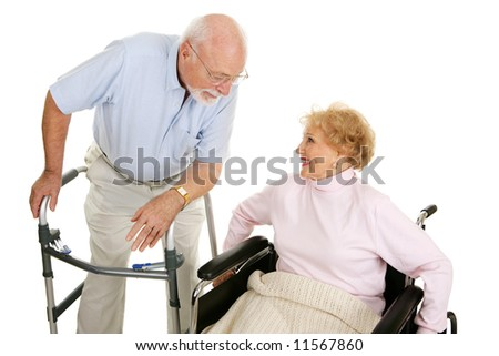 Senior man in walker flirting with a senior lady in a wheelchair.  Isolated on white. - stock photo