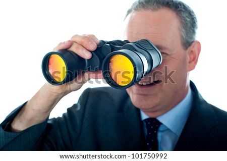 Senior man observing through binoculars isolated over white background - stock photo