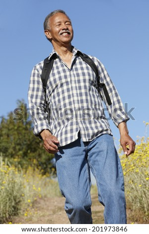 Senior  man on country hike - stock photo