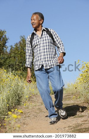 Senior  man on country hike