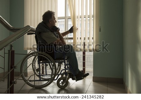 senior man on wheelchair in hospital