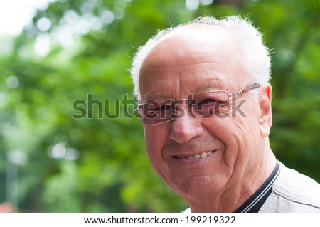 Senior man outside in the nature  - stock photo