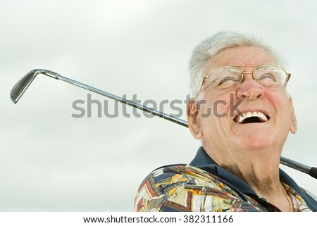 Senior man playing golf - stock photo