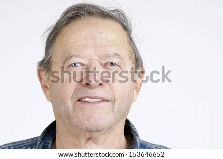 Senior man portrait, looking at camera