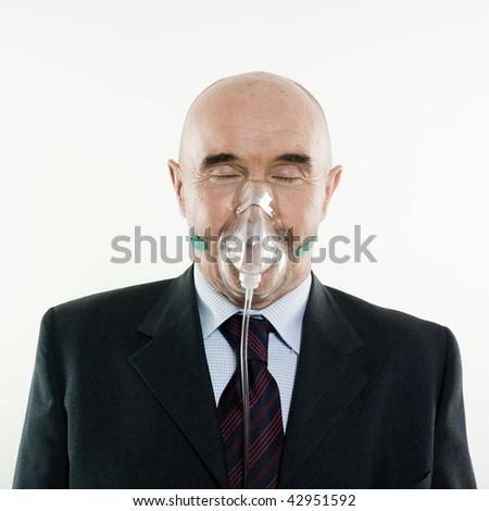 senior man portrait studio wearing oxygen mask - stock photo