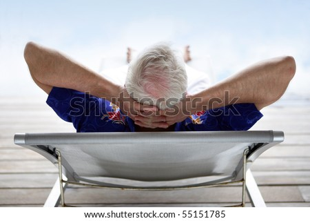 Senior man relaxing in a deck chair - stock photo