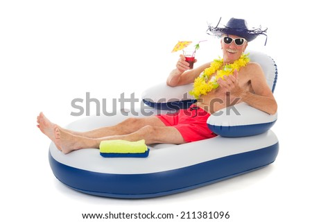 Senior man relaxing while floating in chair in swimming pool - stock photo