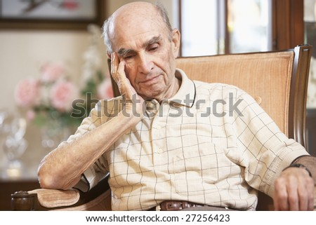 Senior man resting in armchair - stock photo