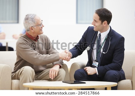 Senior Man Shaking Hands With Doctor