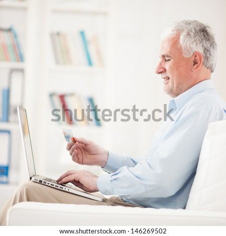 Senior Man Shopping Online - stock photo