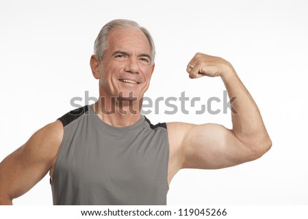 Senior Man Showing Muscle - stock photo
