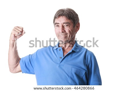 Senior man showing muscle