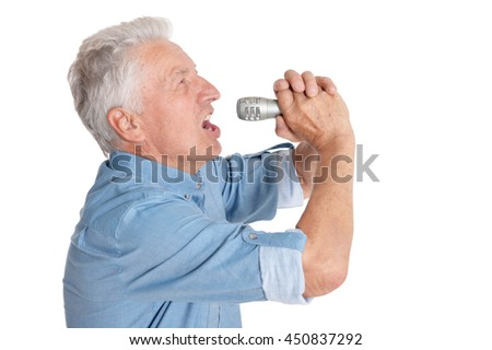 Senior man  singing into microphone