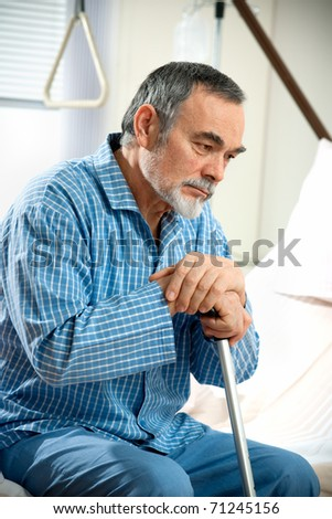 senior man sitting on hospital bed - stock photo