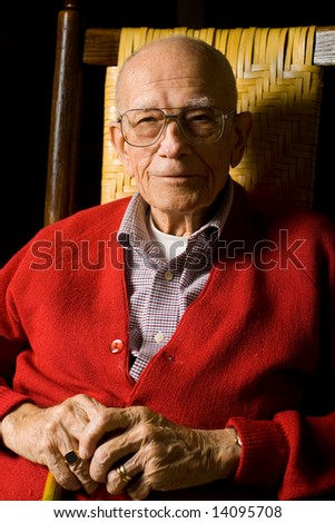 Senior Man Sitting with hands on Cane. - stock photo