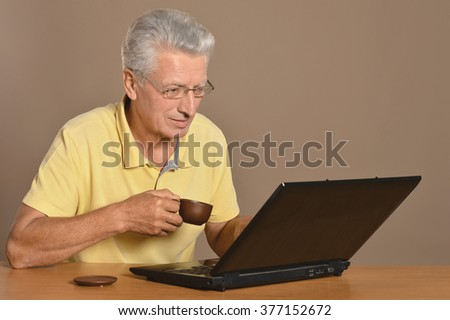 Senior man sitting with laptop