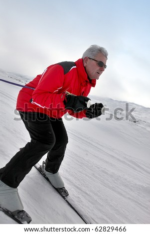 Senior man skiing on snow
