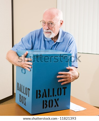 Senior man stealing a ballot box from an election polling place. - stock photo