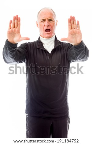 Senior man stopping with hand gesture - stock photo