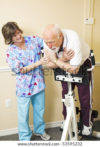 Senior man struggles to do physical therapy for his back problems. - stock photo