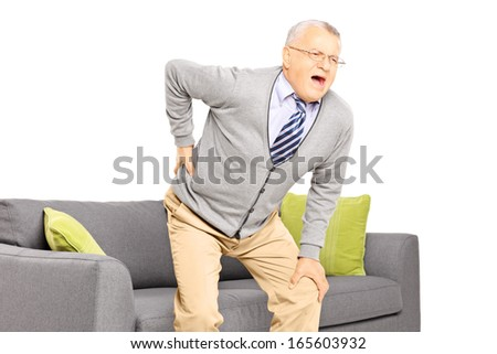 Senior man suffering from back pain isolated on white background - stock photo