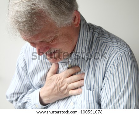 senior man suffering from bad pain in his chest - stock photo