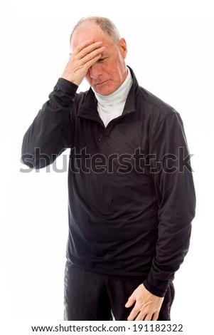 Senior man suffering from headache - stock photo